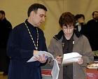 Fr Michael confers with Carole Buleza